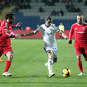 Besiktas's Gokhan Tore (R) and Kasimpasa's Sancak Kaplan (C) during their Turkish Super League soccer match Istanbul Besiktas between Kasimpasa at the Basaksehir Fatih Terim Arena at Basaksehir in Istanbul Turkey on Sunday, 23 November 2014. Photo by Aykut AKICI/TURKPIX