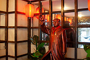 Famous waving Mao Zedong statue outside a restaurant in Shanghai, China. Mao Zedong, commonly known as Chairman Mao, was a Chinese communist revolutionary who became the founding father of the Peoples Republic of China, which he ruled as the Chairman of the Communist Party.