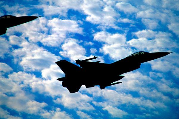 Silhouette of Jets Flying Over Ellington Field