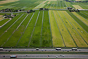 Nederland, Zuid-Holland, Leidschendam, 12-05-2009; Groene Hart: zicht op de Drooggemaakte Grote Polder met autosnelweg A4 in de voorgrond.Swart collectie, luchtfoto (toeslag); Swart Collection, aerial photo (additional fee required)