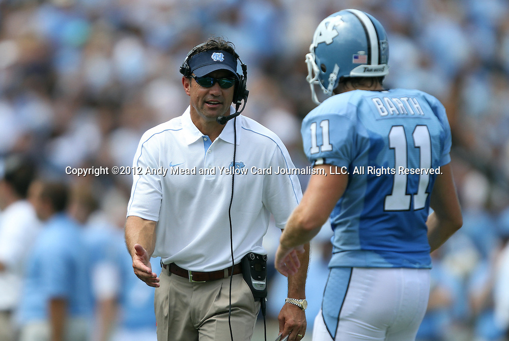 01 September 2012: UNC head coach Larry Fedora (left) with kicker Casey Barth (11). The University of North Carolina Tar Heels played the Elon University Phoenix at Kenan Memorial Stadium in Chapel Hill, North Carolina in a 2012 NCAA Division I Football game. UNC won the game 62-0.