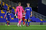 AFC Wimbledon midfielder Jack Rudoni (12) about to bump fists with Doncaster Rovers goalkeeper Ian Josef Bursik (1) during the EFL Sky Bet League 1 match between AFC Wimbledon and Doncaster Rovers at Plough Lane, London, United Kingdom on 3 November 2020. The first League match at the new stadium.