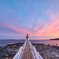 New England photography of Marshall Point Light with its iconic wooden walkway at sunset. This beautiful New England lighthouse is located Port Clyde in Maine and marks the entrance to Port Clyde harbor.<br /> <br /> This iconic Maine lighthouse photography image is available as museum quality photography prints, canvas prints, acrylic prints, wood prints or metal prints. Fine art prints may be framed and matted to the individual liking and decorating needs:<br /> <br /> https://juergen-roth.pixels.com/featured/marshall-point-lighthouse-juergen-roth.html<br /> <br /> Good light and happy photo making!<br /> <br /> My best,<br /> <br /> Juergen<br /> Photo Prints: http://www.rothgalleries.com<br /> Photo Blog: http://whereintheworldisjuergen.blogspot.com<br /> Instagram: https://www.instagram.com/rothgalleries<br /> Twitter: https://twitter.com/naturefineart<br /> Facebook: https://www.facebook.com/naturefineart