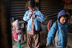 Sumitra, 10, and Sushil, 7, get ready for school. <br /> <br /> Niruta and Durga were married 9 years ago, when they were just 14 and 16 years old in the Kagati village of Nepal. The 2015 earthquakes devastated Nepal and left girls and women in an increasingly vulnerable position, leading experts to believe child marriage rates will increase over the coming years.