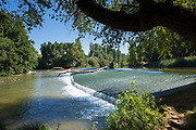 Weir on gently flowing River Duero in Castile and Leon, Spain