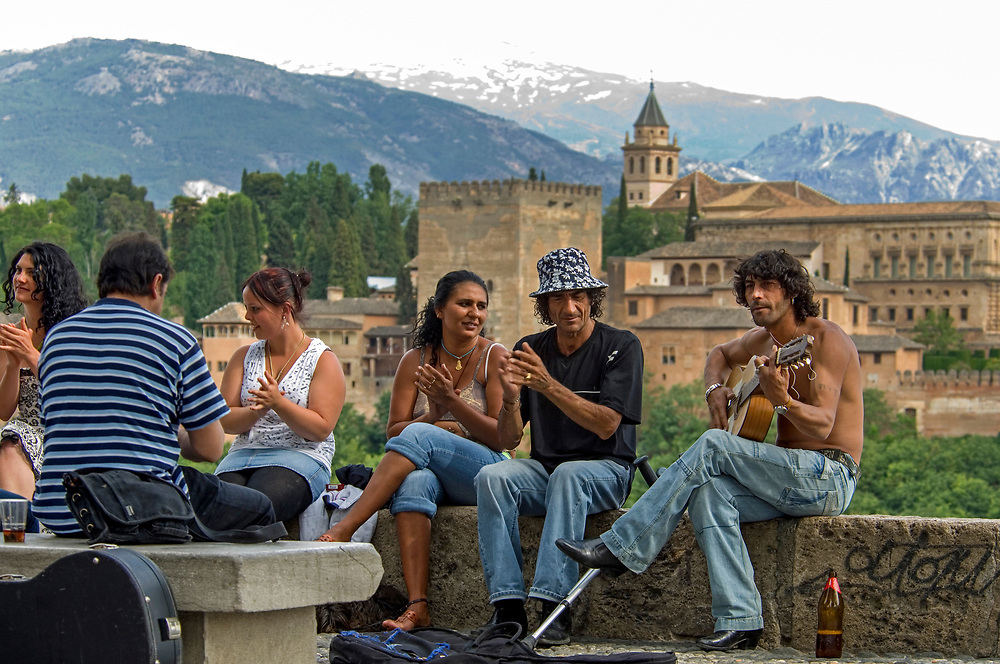 Andalucian afternoon in front of he Alhambra Palace, masterpiece of Moorish architecture in Granada, Andalucia.