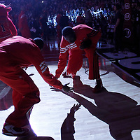 30 March 2012:  Chicago Bulls small forward Luol Deng (9) and Chicago Bulls shooting guard Ronnie Brewer (11) are seen during the players introduction prior to the Chicago Bulls 83-71 victory over the Detroit Pistons at the United Center, Chicago, Illinois, USA. NOTE TO USER: User expressly acknowledges and agrees that, by downloading and or using this photograph, User is consenting to the terms and conditions of the Getty Images License Agreement. Mandatory Credit: 2012 NBAE (Photo by Chris Elise/NBAE via Getty Images)