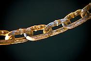 Photo Randy Vanderveen, Sept. 24/08.Grande Prairie, Alberta.A rusting chain hangs down over the dark waters of Crystal Lake