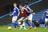 David Jones of Burnley shields the ball from Kevin Bru of Ipswich Town. Skybet football league Championship match, Burnley v Ipswich Town at Turf Moor in Burnley, Lancs on Saturday 2nd January 2016.<br /> pic by Chris Stading, Andrew Orchard sports photography.