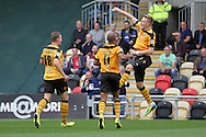 Joe Pigott of Newport (right) celebrates after scoring his side's second goal. Skybet football league two match, Newport county v AFC Wimbledon at Rodney Parade in Newport, South Wales on Saturday 27th Sept 2014<br /> pic by Mark Hawkins, Andrew Orchard sports photography.