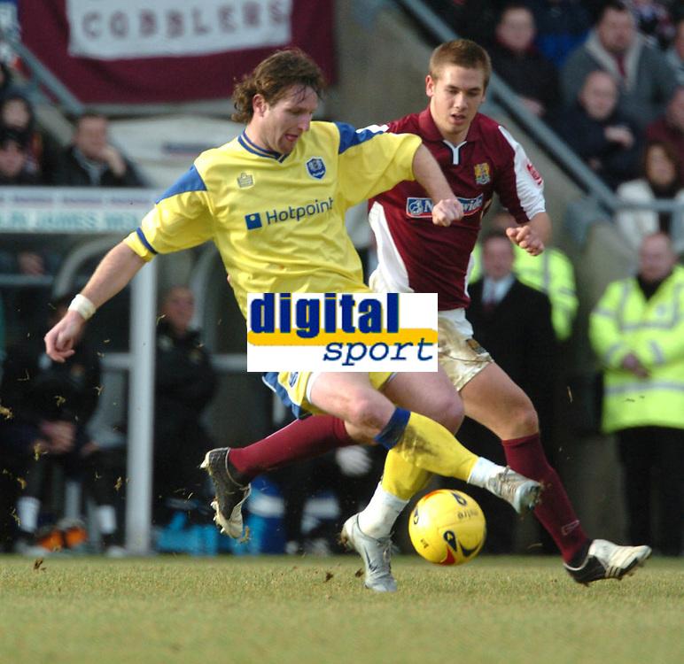 Photo: Ian Hebden.<br /> Northampton Town v Peterborough United. Coca Cola League 2. 31/12/2005.<br /> 05 Peterboroughs James Quinn evades Northamptons Luke Chambers.
