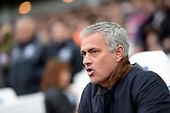 Jose Mourinho, the Chelsea manager looks on from the dugout .Barclays Premier League, West Ham Utd v Chelsea at The Boleyn Ground, Upton Park in London on Saturday 24th October 2015.<br /> pic by John Patrick Fletcher, Andrew Orchard sports photography.
