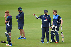 England head coach Trevor Bayliss and captain Eoin Morgan (right) during the nets session at Cardiff Wales Stadium.