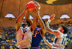Jan 19, 2019; Morgantown, WV, USA; West Virginia Mountaineers forward Derek Culver (1) and Kansas Jayhawks forward David McCormack (33) fight for a rebound during the first half at WVU Coliseum. Mandatory Credit: Ben Queen-USA TODAY Sports