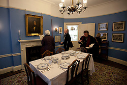 © Licensed to London News Pictures. 10/12/2012. London, UK. Visitors explore former dining room of Charles Dickens after the Charles Dickens Museum re-opened its doors to the public in London today (10/12/12). The museum, spread over 4 floors, is housed in the building where Dickens lived with his wife from March 1837 to December 1839 and where he authored some of his famous titles including the Pickwick Papers, Nicholas Nickleby and Oliver Twist. Photo credit: Matt Cetti-Roberts/LNP