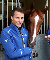 Winning jockey William Buick poses with Masar during the homecoming event at Moulton Paddocks, Newmarket.