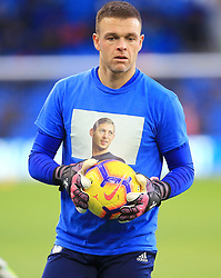 Cardiff City goalkeeper Brian Murphy wears a Emiliano Sala t-shirt in remembrance during the Premier League match at the Cardiff City Stadium.