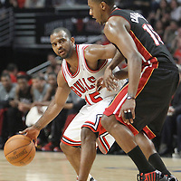 14 March 2012: Chicago Bulls point guard John Lucas III (15) looks to pass the ball past Miami Heat point guard Mario Chalmers (15) during the Chicago Bulls 106-102 victory over the Miami Heat at the United Center, Chicago, Illinois, USA.