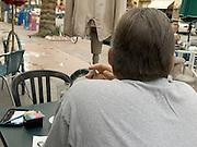 man smoking after dinner