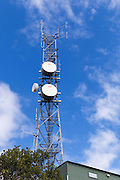 Microwave and mobile radio communications antenna array on a tower on hill in Charters Towers, Queensland, Australia <br /> <br /> Editions:- Open Edition Print / Stock Image