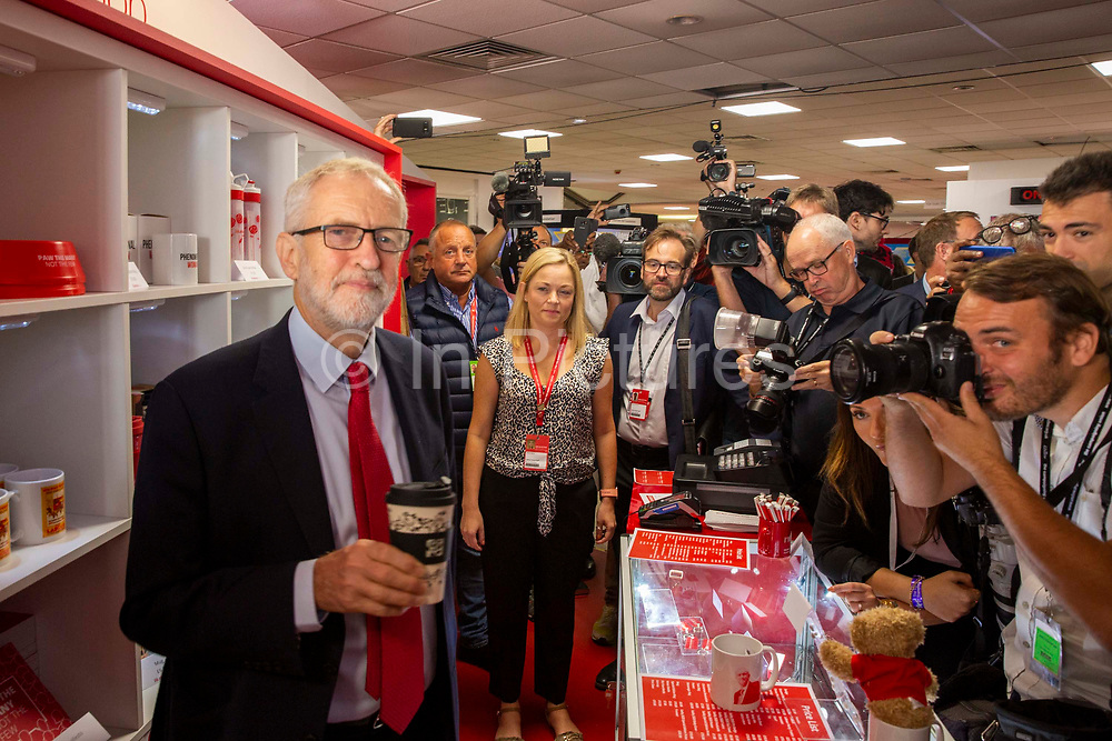 Labour Party Leader Jeremy Corbyn holds a reusable Labour Party coffee cup at the Labour Party shop on the third day of the Labour Party conference on Monday, September 23rd, 2019 in Brighton, United Kingdom.
