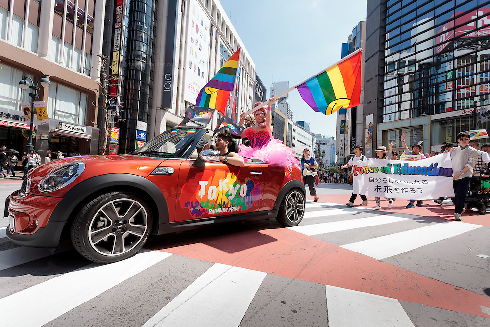 Drag-Queens sit in a mini car at The Rainbow Pride Event in Shibuya, Tokyo, Japan. Sunday, April 26th 2015. This is the forth annual celebration of LGBT issues in Tokyo and forms part of a wider Rainbow Week. About 5% of the Japanese population identify as homosexual and this event hopes to foster a society where they can live equally and without prejudice.