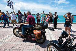 Mike Carson riding his 1930 Harley-Davidson VL over the finish line of the Cross Country Chase motorcycle endurance run from Sault Sainte Marie, MI to Key West, FL. (for vintage bikes from 1930-1948). The Grand Finish in Key West's Mallory Square after the 110 mile Stage-10 ride from Miami to Key West, FL and after covering 2,368 miles of the Cross Country Chase. Sunday, September 15, 2019. Photography ©2019 Michael Lichter.