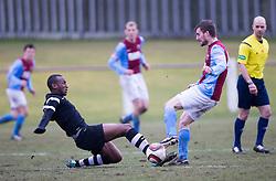 Edusport Academy Ibrahim Diallo and Whitehill Welfare John Ross Kerr. <br /> Whitehill Welfare 2 v 1 Edusport Academy, South Challenge Cup Quarter Final played 7/3/2015 at Ferguson Park, Carnethie Street, Rosewell.