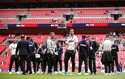 Derby County players inspects the pitch before the game