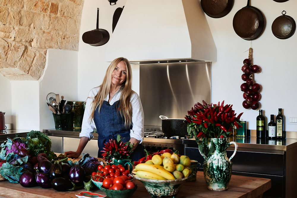 Collette Dinnigan, posing in her villa's kitchen. Ostuni, Italia. September 28, 2019.