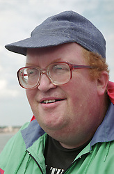 Portrait of volunteer support worker for people with learning disabilities wearing baseball cap and