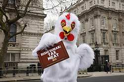 © Licensed to London News Pictures. 03/03/2021. London, UK. A person in a chicken costume from the campaiging group PETA is seen outside Downing Street on Budget Day. The group are calling for a meat tax. Later Chancellor Rishi Sunak will deliver his budget to Parliament. Photo credit: Peter Macdiarmid/LNP