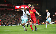 James Milner of Liverpool and Andrew Ayem of West Ham United during the Premier League match at Anfield Stadium, Liverpool. Picture date: December 11th, 2016.Photo credit should read: Lynne Cameron/Sportimage