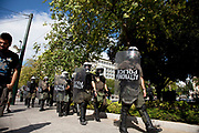 Riot police presence as students and teachers demonstrate against austerity measures and planned education reforms in Athens. The demonstration is against an education reform bill which aims to improve the operation of universities.