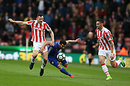 Pedro of Chelsea ©  is fouled by Phil Bardsley of Stoke city (l) .Premier league match, Stoke City v Chelsea at the Bet365 Stadium in Stoke on Trent, Staffs on Saturday 18th March 2017.<br /> pic by Andrew Orchard, Andrew Orchard sports photography.