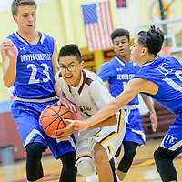 Tohatchi Cougar Dameyne Begay (5) drives to the basket against the Denver Christian Thunders during the Rehoboth Invitational basketball tournament at Rehoboth High School Thursday.