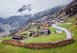 THEMENBILD - Enorm große Windwurfflächen erinnern in Osttirol an das Sturmtief Vaia, das Ende Oktober 2018 Teile des Bezirkes heimsuchte. Besonders stark in Mitleidenschaft gezogen wurden damals das Kalsertal mit 425 Hektar Waldfläche. Hier im Bild Baumstämme auf einem Holzlagerplatz in Oberpeischlach. Aufgenommen am Mittwoch, 29. Oktober 2019 in Oberpeischlach, Kals am Grossglockner // Enormously large windthrow areas in East Tyrol are reminiscent of the stormfront Vaia, which struck parts of the district at the end of October 2018. At that time the Kalsertal with 425 hectares of woodland was particularly badly affected. Here in the picture tree trunks on a wood storage area in Oberpeischlach. Taken on on Wednesday, October 29, 2019 in Kals am Grossglockner. EXPA Pictures © 2019, PhotoCredit: EXPA/ Johann Groder