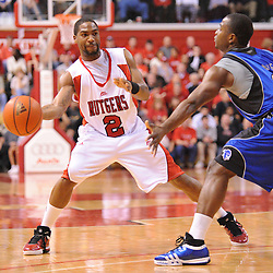Feb 8, 2009; Piscataway, NJ, USA; Rutgers guard Anthony Farmer (2) puts a pass into the paint to center Hamady N'Diaye (not pictured) during the first half of Seton Hall's 65-60 victory at the Louis Brown Athletic Center.
