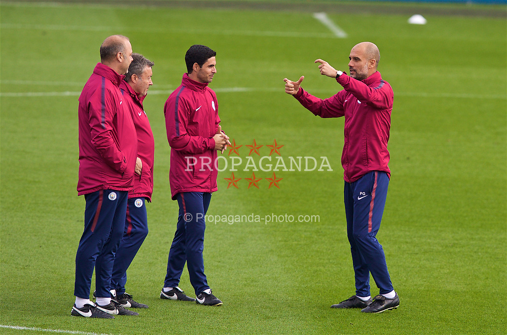 MANCHESTER, ENGLAND - Monday, April 9, 2018: Manchester City's manager Pep Guardiola (right) jokes with assistants Mikel Arteta (centre) and Rodolfo Burrell (left) during a training session at the City Football Academy ahead of the UEFA Champions League Quarter-Final 2nd Leg match between Manchester City FC and Liverpool FC. (Pic by David Rawcliffe/Propaganda)