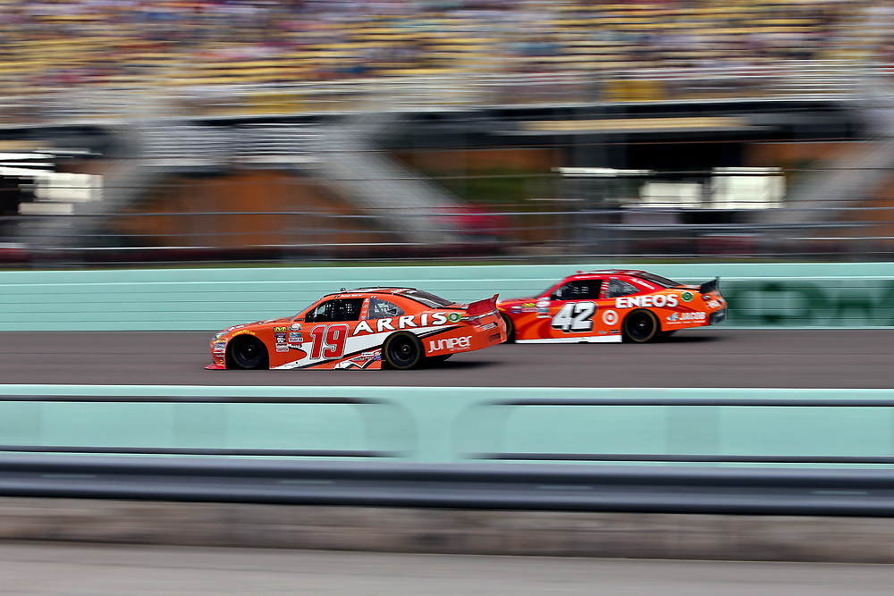 Nov 19, 2016; Homestead, FL, USA; NASCAR Xfinity Series driver Daniel Suarez (19) passes NASCAR Xfinity Series driver Kyle Larson (42) during the Ford Ecoboost 300 at Homestead-Miami Speedway. Mandatory Credit: Peter Casey-USA TODAY Sports