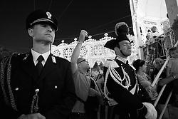 Un carabiniere ed un poliziotto fotografati a Mesagne (Br) durante la festa in onore della Madonna del carmine.Come ogni anno il 15, 16 e 17 di luglio si festeggia la Vergine in quanto protettrice del paese per aver salvato la popolazione da un terribile terremoto avvenuto nel 1700 circa.