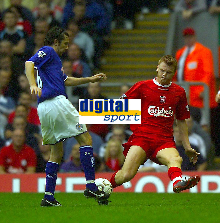 Photo. Jed Wee.<br /> Liverpool v Leicester City, FA Barclaycard Premiership, Anfield, Liverpool. 20/09/2003.<br /> Liverpool's John Arne Riise (R) tries to stop Leicester's Muzzy Izzet.