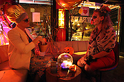 Amanda Barr reads the fortune of a woman dressed in a Day of the Dead costume at Bow Bar in Carrboro, North Carolina.
