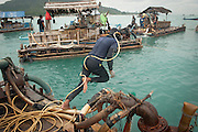 The hidden side of high tech smartphones. Diver on an improvised offshore tin mining platform. He can dig out 15 kg of tin sand per day.<br /> Tin mines offshore near the fishing village Reboh. These mines destroy the seabed, coral reefs and kill fish.<br /> Bangka Island (Indonesia) is devastated by illegal tin mines. The demand for tin has increased due to its use in smart phones and tablets.<br /> <br /> Plongeur sur radeau de mine off shore depuis 5 ans. Il peut extraire 15 kilo d'étain par jour.  <br /> Mines d'étain off shore au large de Reboh, village de pecheurs. Ces mines détruisent les fonds sous marins, les barrières de corail et tuent les poissons. <br /> L'île de Bangka (Indonésie) est dévastée par des mines d'étain sauvages. la demande de l'étain a explosé à cause de son utilisation dans les smartphones et tablettes.
