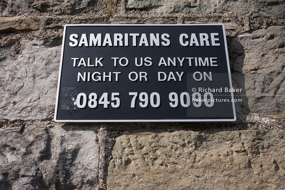 A Samaritans suicide 0845 helpline sign on Brunel's Clifton suspension bridge in Bristol.