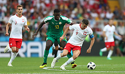 Senegal's Alfred N'Diaye (left) and Poland's Robert Lewandowski battle for the ball