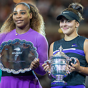 2019 US Open Tennis Tournament- Day Thirteen.    Bianca Andreescu of Canada with the winners trophy and Serena Williams of the United States with the runners up trophy after the Women's Singles Final on Arthur Ashe Stadium during the 2019 US Open Tennis Tournament at the USTA Billie Jean King National Tennis Center on September 7th, 2019 in Flushing, Queens, New York City.  (Photo by Tim Clayton/Corbis via Getty Images)