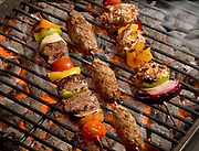 grilling Shish Kebab on open grill