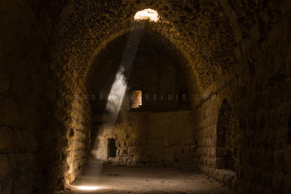A beam of light falls on a dust cloud at Kerak Castle, Kerak, Jordan. Photo © Robert van Sluis