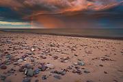 Spectacular sunrise with colorful rain clouds and rainbow over dunes and baltic sea, near Ventspils, Kurzeme, Latvia Ⓒ Davis Ulands | davisulands.com